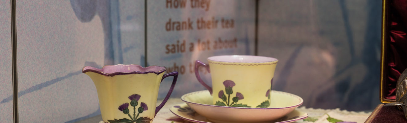 Image: Teacups and cloth with Scottish Thistle pattern