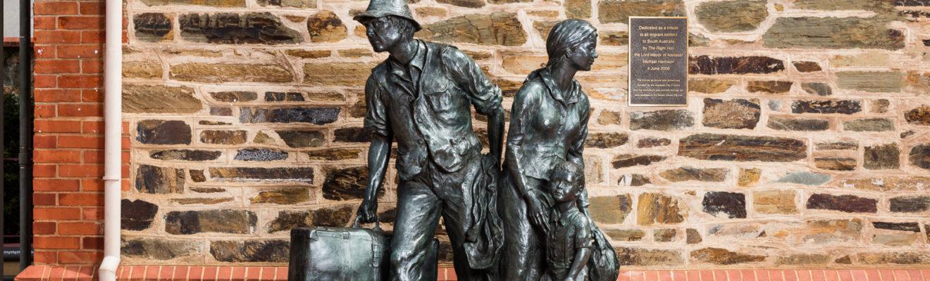 Statue of family migrating to Australia